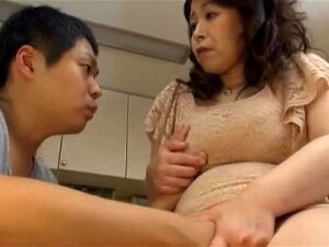 Busty Japanese MILF Spreads Her Legs To Be Pleasured On The Bed Porn