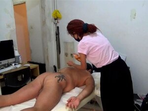 Nasty Masseuse Is Giving A Full Body Massage To A Impressive Man With Several Tattoos Porn