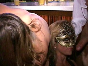 Masks And Booze Turn MILFs Slutty. Pink Nipple MILF Sucks Tits Of Cougar Sitting Next To Her In Trapeze Atlanta Swingers Bar. Both Blow Cougar Hubby As MILF Hubby Fingers Both Cunts. Porn