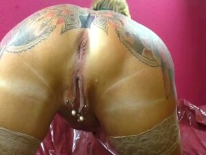 Tattooed Woman Spitting Butt Plugs Out Of Her Asshole Porn