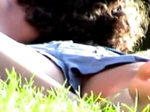 A Ral Amateur Chick Is In The Summer Park Lying And Relaxing On The Green Grass. Wearing Tiny Shorts She Does Not Care Somebody Would See She Is Not Wearing Panty Underneath. Porn