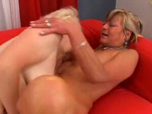 Jane And Mellane Are A Couple Mature, Blonde Haired, Lesbian MILFs, That You'll Get To Watch Laying On Their Couch, Giving Each Other Cunnilingus. They Both Have Natural Hooters But, One Is Very Tan And Has A Belly Piercing That You'll Get To See When The Older Grannie Gets Out One Of Her Sex Toys And Slides It Deep Into Her Lover's Box For An Orgasm. Porn