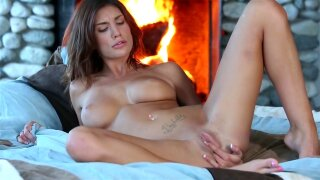 Big-tit August Ames is poking her pussy