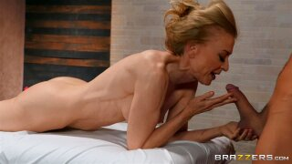Mature skinny granny Nina Hartley seduces a younger masseuse