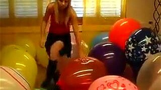 Sexy girl blonde looner having lots of fun with multiple balloons